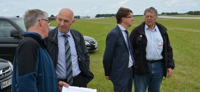 Mayor of Skive Municipality, Peder Christian Kirkegaard, seen second from left as he talks with competition Director for WPFC 2015, Allan Hansen.